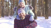 lodowisko : a little girl with her father throwing snow in the winter forest