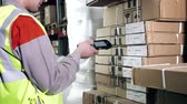 A warehouse worker uses a barcode scanner