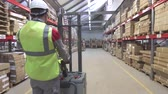 stacking : Man on forklift transporting cargo