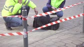 угроза : two police sappers next to a dangerous object, bag bomb attack on the street