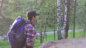 экспедиция : man tourist in plaid shirt walking in the Park with a large backpack
