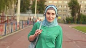 muslimah : sports young Muslim girl with a backpack on the athletic track Stock Footage