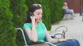 срочный : Attractive girl in a wheelchair speaks on the phone,slow mo Стоковые видеозаписи