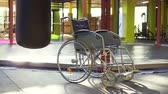 kurtarma : A wheelchair is in the gym.The concept of sports injury.Slow mo Stok Video