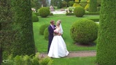 romantic : portrait of a couple of newlyweds in a beautiful garden
