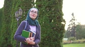 ders kitabı : Portrait of muslim student with books ,slow mo
