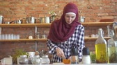 потеря в весе : Young muslim woman in kitchen cuts vegetables to cook food