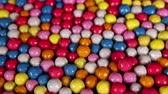 Candies. Sugar coated bonbons candy background mini footage video clip