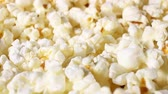 Popcorn popcorns rotating food texture closeup video footage. Studio lighting. Stock Footage