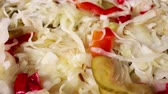 Coleslaw rotating food texture closeup video footage. Studio lighting.