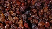 kuru üzüm : Raisins. Raisin grains rotating pattern macro texture background backdrop footage video. Stok Video