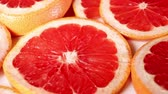 ilustrado : Grapefruits. Grapefruit slices rotating pattern macro texture background backdrop footage video.