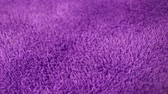Purple Carpet fabric rotating pattern macro texture background backdrop footage video.