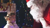 coat : Santa gives a gift box to cute little girl, Christmas Stock Footage