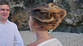 evlenmek : Portrait of Bride Holds Wedding Bouquet and Groom at Background Stok Video