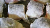 деликатес : Frying pieces of fish closeup