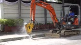 Bangkok, Thailand - July 7, 2017 The drilling machine is drilling concrete pavement to excavate and water supply pipes