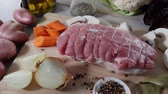 butchers : preparation of uncooked roast pork with mushrooms Stock Footage