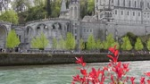 View of the cathedral in Lourdes, France, with gave de Pau Wideo