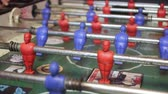 ピッチ : Close-up shot of people playing an old vintage game of fussball. 動画素材