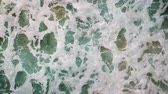 algarve : Aerial drone shot of whitewater waves rolling in on a beach in Algarve, Portugal. Stock Footage