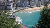Aerial view over a beautiful beach in the city of San Sebastian, Basque country, Spain Stock Footage