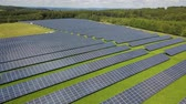 Solar panel farm with photovoltaic panels for clean solar energy. Drone footage Stock Footage