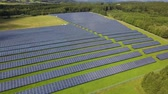 Solar panel farm with photovoltaic panels for clean solar energy. Drone footage Wideo