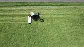 Aerial view of a tractor operating in the field Stock Footage
