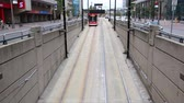Toronto, Canada - Oct 11, 2017: Time lapse of a modern streetcar driving into a tunnel in the city of Toronto. Province of Ontario, Canada Wideo