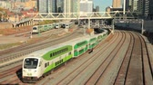 Торонто : Toronto, Canada - Oct 20, 2017: Time lapse of green double decker trains passing by in the city of Toronto. Province of Ontario, Canada