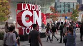 Toronto, Canada - Oct 21, 2017: Time lapse of people taking pictures at the La Tour CN Tower sign in the city of Toronto. Province of Ontario, Canada