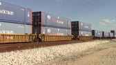 cargo container : Picacho, Az,, USA - October 18, 2014: Freight train containers moving along the track towards its destination. Taken October 18, 2014 Stock Footage