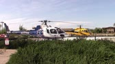 rescue : Mesa, Arizona, USA - April 21 2015:  Two medi-vac emergency helicopters on standby in the hospital parking lot Taken April 21, 2015
