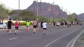 fitness : Mesa, Arizona, USA - February 27, 2016: Runners from all over the US participated in the BMO Harris Bank Marathon.Rear view of runners participating in a marathon Stock Footage