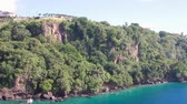 liman bölgesi : Panorama of rocky tropical coast. Kingstown, Saint Vincent and Grenadines Stok Video