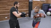 kickboks : Two young male boxers are training in the gym. Kyiv UA, 28-03-2019