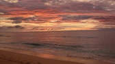 облака : Spectacular red sunset on the beach sea view waves Стоковые видеозаписи