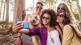 forest : Hipster group is taking selfies Stock Footage