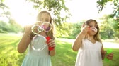 little : Little girls blowing soap bubbles