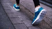 fitness : Closeup of womans feet running in slow motion on asphalt