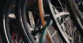 felhasználatlan : Close up slow motion shot of bicycle wheels and spokes with a reflector placed in between the spokes