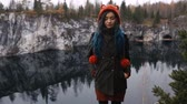 karelia : Pretty nice girl enjoy beautiful lake view from the hilltopl and good weather in Karelia. Around the rocks.