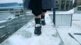 csillog : Girl dancing in boots in the snow