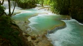 sıra : Turquoise natural swimming pools of the Kuang Si Falls, one of southeast Asia�s most beautiful water falls and a must visit around Luang Prabang. Stok Video