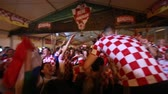 ZAGREB, CROATIA - JULY 7TH, 2018 : Croatian football fans celebrate Croatian quarter final victory over Russia on Fifa World cup 2018 on Ban Jelacic Square in Zagreb, Croatia. Stock Footage