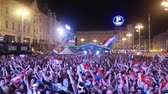 ZAGREB, CROATIA - JULY 11, 2018 : Croatian football fans celebrating victory of 2:1  Croatia vs England in semifinals Fifa World cup 2018 on Ban Jelacic Square in Zagreb, Croatia.