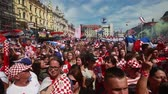 ZAGREB,CROATIA - JULY 16,2018 : Croatia National Team welcome home celebration for 2nd place on Fifa World Cup. Croatian football fans singing while waiting for players to arrive on Ban Jelacic square.