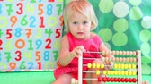 jardim de infância : Cute baby girl counting on abacus, playing game in daycare with financial tools, elementary education. Full HD Video 1920x1080