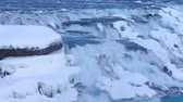 Amazing panoramic view on Golden Falls, Gullfoss, a powerful stream of water runs between stones, famous tourist attraction, beautiful nature of Iceland. Full HD Video 1920x1080